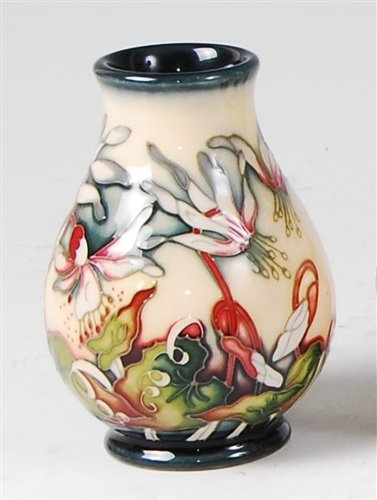 Lot 15 - A small Moorcroft pottery vase in the Minuet...