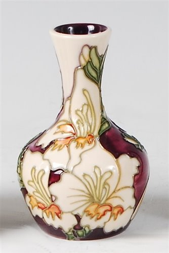 Lot 17-A small Moorcroft pottery vase in the Gladioli...