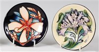 Lot 18-A Moorcroft pottery circular pin tray in the...