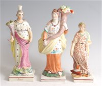 Lot 1090 - A 19th century Staffordshire figure of a lady,...