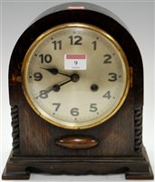 Lot 9-A 1920s oak cased dome top mantel clock having a...