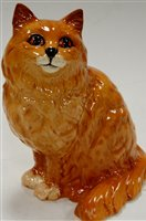 Lot 11-A Beswick model of a cat in seated pose impressed ...