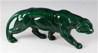 Lot 49-An Art Deco glazed ceramic model of a prowling...