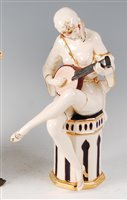 Lot 47-Royal Dux - an Art Deco glazed pottery figure...