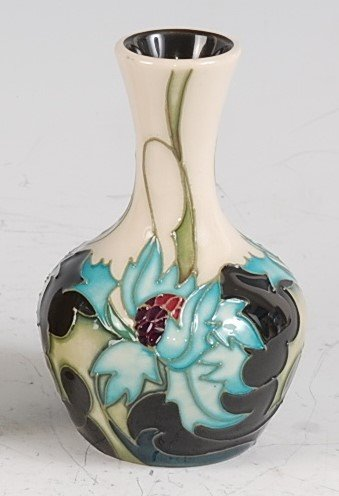 Lot 24-A Moorcroft pottery vase in the Sea Holly pattern,...