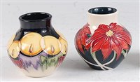Lot 25-A Moorcroft pottery squat vase in the Candle...