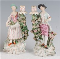 Lot 1094 - A pair of 18th century Derby porcelain figural...