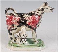 Lot 1095 - A circa 1800 Prattware cow creamer with...