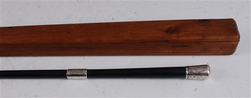 Lot 521-An ebony and silver mounted conductor's baton,...