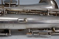 Lot 509-A cased silver plated alto saxophone, Martin...