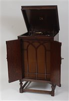 Lot 516-An Oak cased HMV model 194 re-entrant tone...