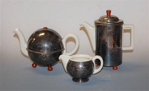 Lot 13-A German porcelain three-piece tea service,...