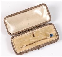 Lot 2503-A convertible sapphire stick pin: the round blue...