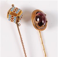 Lot 2505-Two stick pins: the first set with a garnet...
