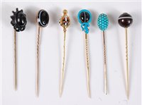 Lot 2514-Six gemset stick pins: a banded agate and blue...