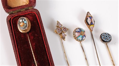 Lot 2515 - Five stick pins: a pietra dura stick pin, the...