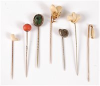 Lot 2518-Seven stick pins: a stags tooth stick pin, the...