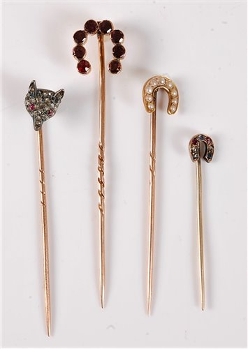 Lot 2519-Four gemset stick pins: a diamond fox head stick...