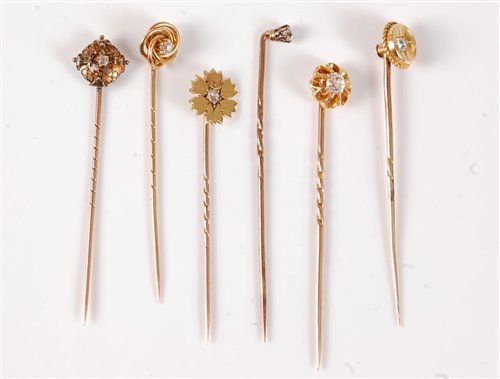 Lot 2521-Six diamond set stick pins: an old cut diamond...