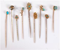 Lot 2522-Nine stick pins: to include a 15ct diamond...