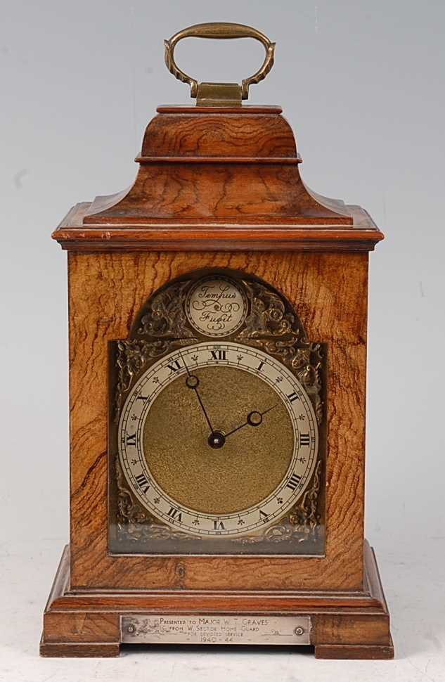 Lot 36-A mid-20th century walnut cased mantel clock