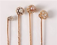 Lot 2524-Four diamond and seed pearl stick pins: to...