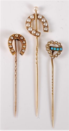Lot 2525-Three stick pins: a 15ct split pearl stick pin,...