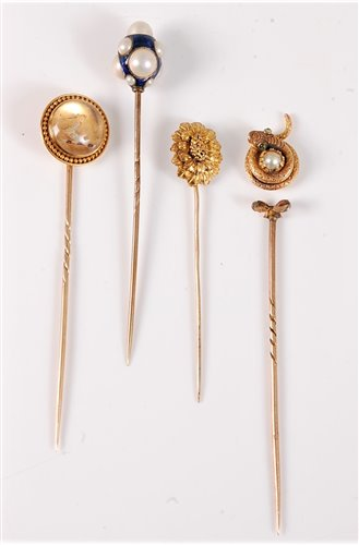 Lot 2526-Four stick pins: to include a reverse painted...