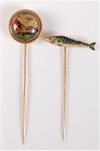 Lot 2527-Two stick pins of sporting interest: a reverse...