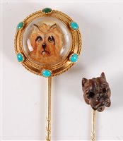 Lot 2528-Two stick dog stick pins: a reverse painted...