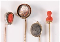 Lot 2530-Four cameo stick pins: a round painted porcelain...