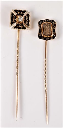 Lot 2535-Two 19th century mourning stick pins: a diamond...