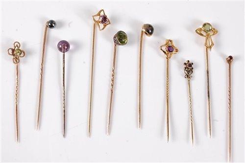 Lot 2536-Ten gemset stick pins: a moss agate stick pin...