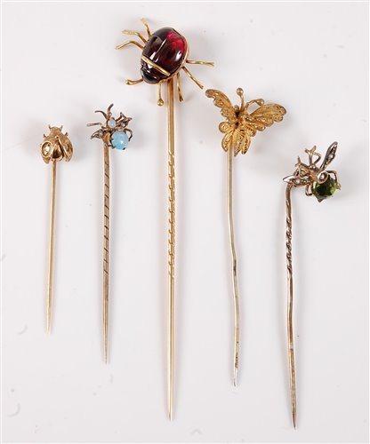 Lot 2537-Five insect stick pins: a garnet spider stick pin,...