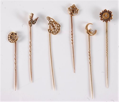 Lot 2541-S ix diamond and seed pearl stick pins: a 15ct...