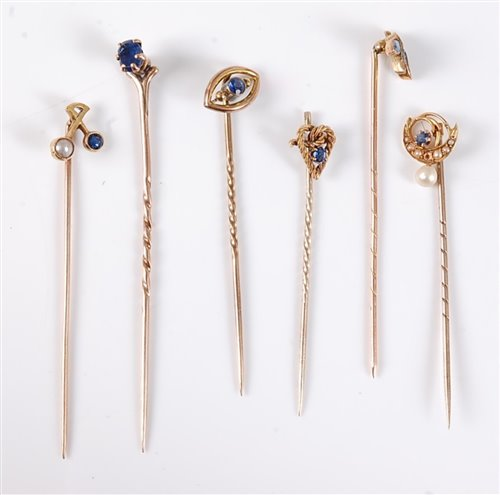 Lot 2542-Six sapphire and seed pearl stick pins: a 15ct...
