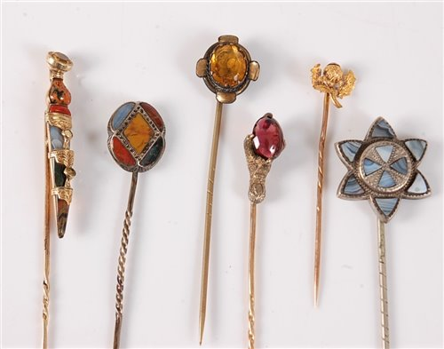 Lot 2543-Six gemset stick pins: a multi gemset dirk stick...