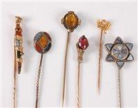 Lot 2543-Six gemset stick pins: a multi gemset dirk stick...