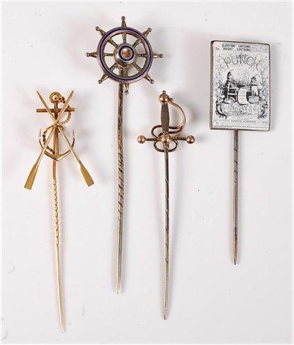 Lot 2544-Four stick pins: an anchor and oars stick pin,...