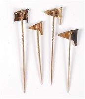 Lot 2545-Four enamelled flag stick pins: a blue, yellow...