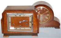 Lot 6-An Art Deco oak cased mantel clock, having a...