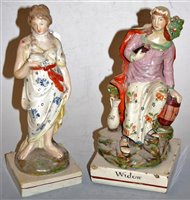 Lot 12-A 19th century pearlware figure of The Widow of...