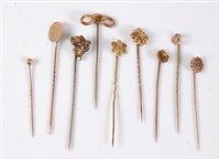 Lot 2550-Nine stick pins: to include a 15ct stick pin;...