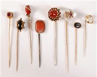 Lot 2552-Eight gemset stick pins: a rock crystal with...