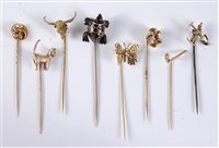 Lot 2553-Eight various stick pins: a 9ct cat stick pin,...