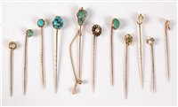 Lot 2556-Eleven gemset stick pins: to include a 15ct Arts...