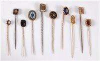 Lot 2557-Ten various stick pins: to include garnet,...