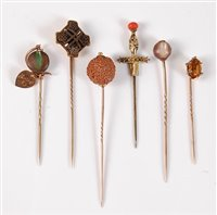 Lot 2559-Six various stick pins: to include a Celtic cross ...
