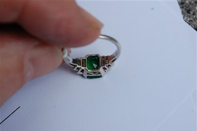 Lot 1258-An emerald and diamond ring, the octagonal step...