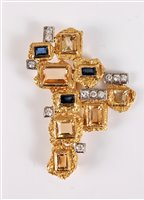 Lot 264 - A gemset pendant/brooch by Charles de Temple,...